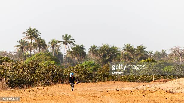 African woman on the road, The Gambia.