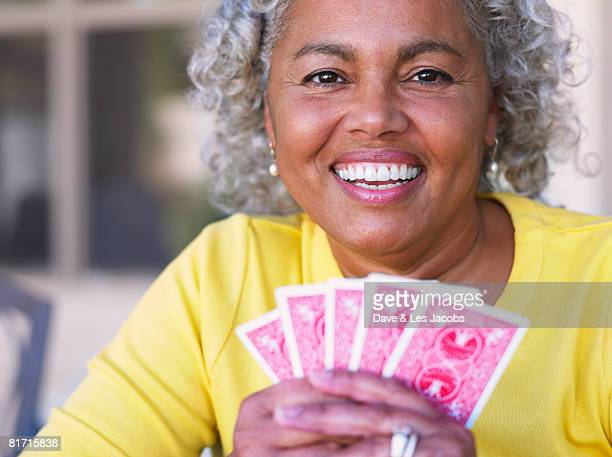 African woman playing cards