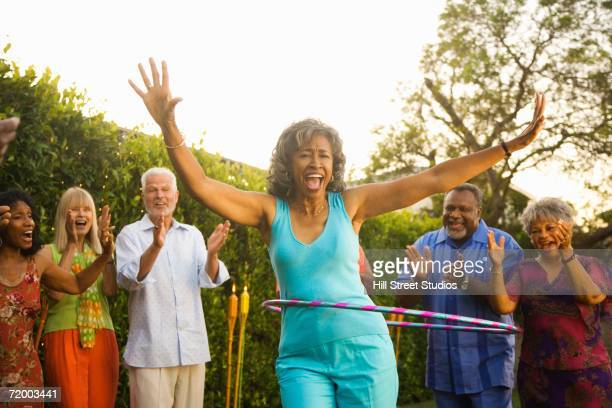 African woman playing with hula hoop outdoors