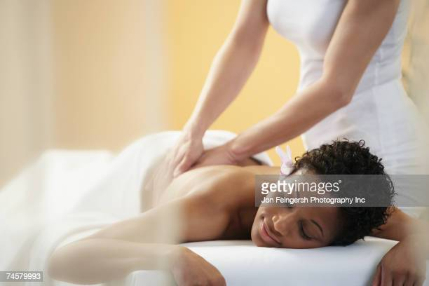 african woman receiving massage - massage stock pictures, royalty-free photos & images