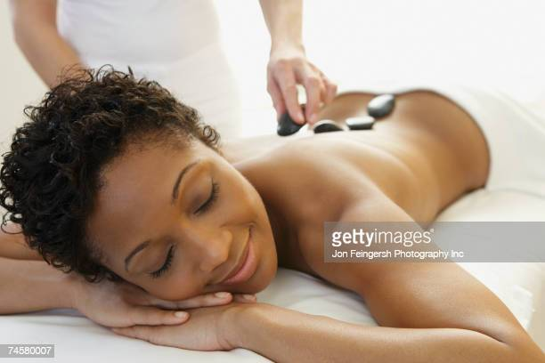 african woman receiving spa treatment - massage black woman stock photos and pictures