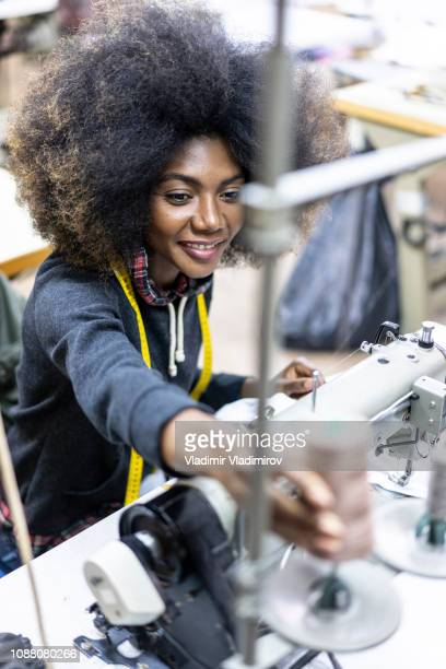 african woman sewing in clothes factory - garment stock pictures, royalty-free photos & images
