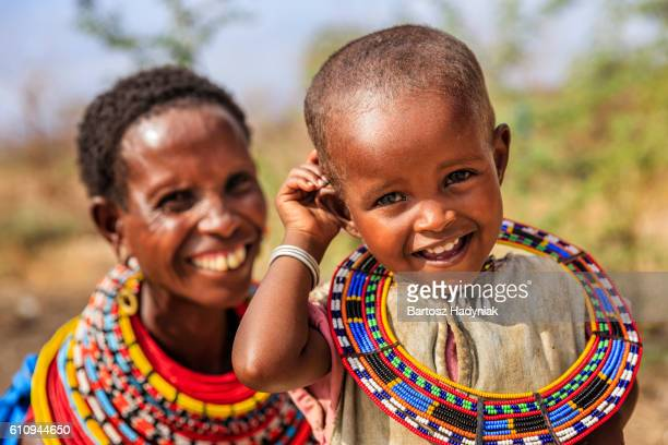 african woman sitting with her baby, kenya, east africa - kenya stock pictures, royalty-free photos & images