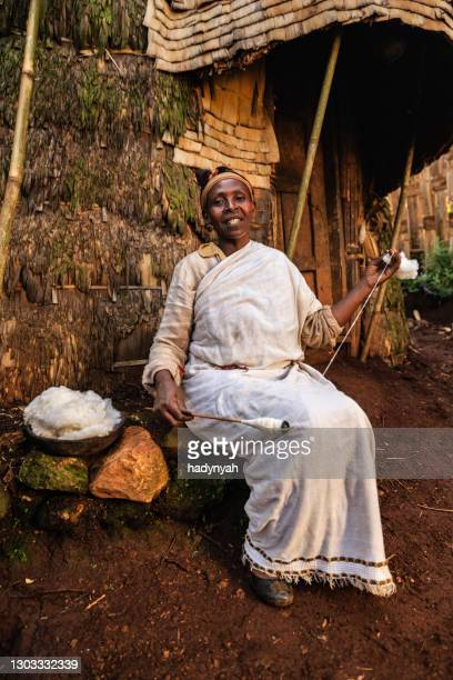 african woman spinning a wool, east africa - horn of africa stock pictures, royalty-free photos & images