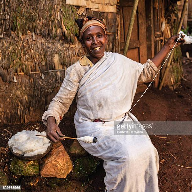 African woman spinning a wool, East Africa