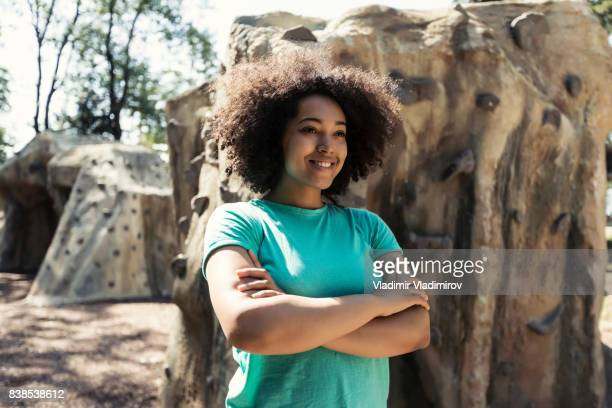 african woman standing arms crossed in front of climbing wall - plus size model stock pictures, royalty-free photos & images