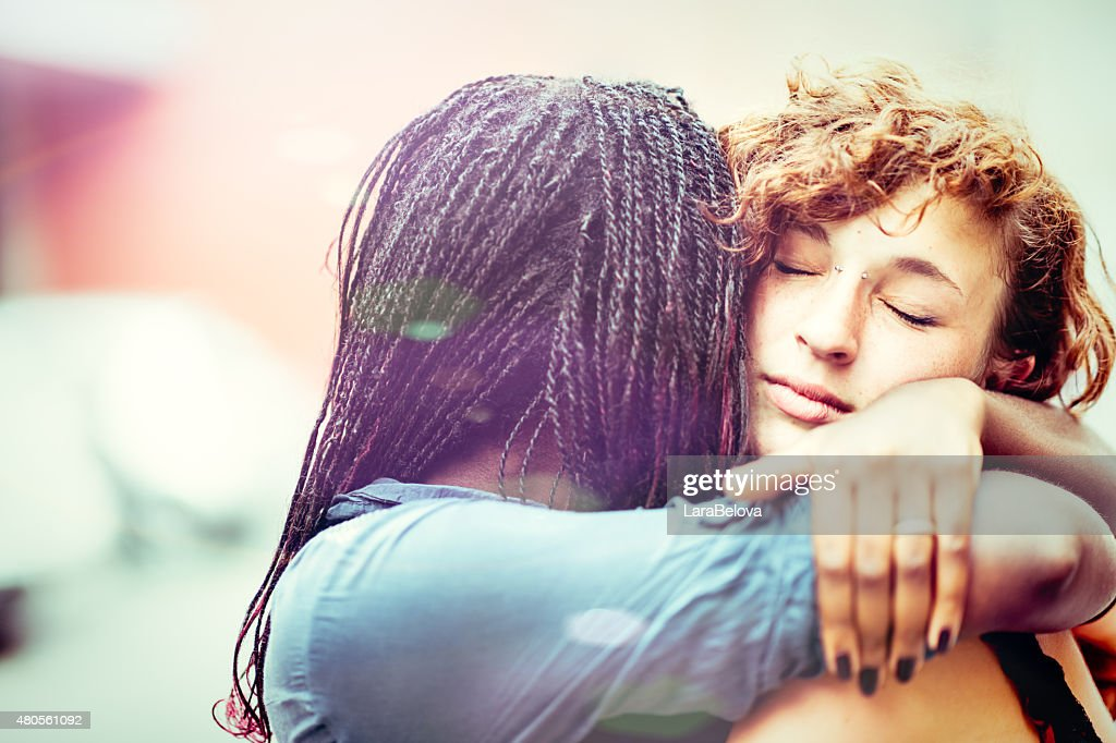 African woman supporting her Caucasian girlfriend : Stock Photo