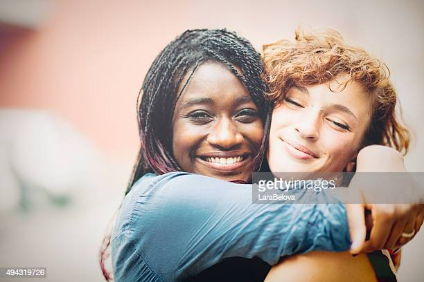 african woman supporting her caucasian girlfriend - arm around stock pictures, royalty-free photos & images