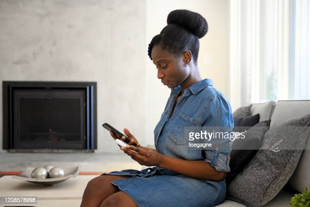african woman taking blood sugar level in different time of the day - glucose stock pictures, royalty-free photos & images