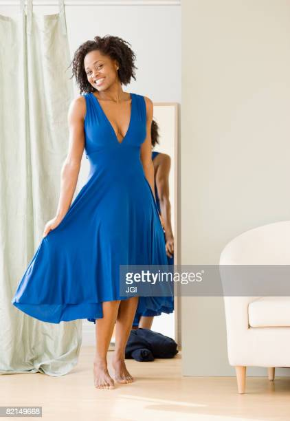 african woman trying on dress - fitting room stock pictures, royalty-free photos & images