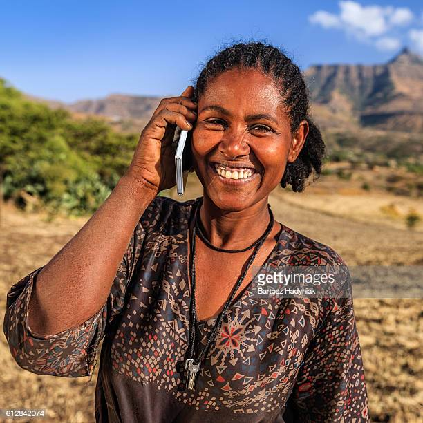 African woman using mobile phone, village near Lalibela, Ethiopia