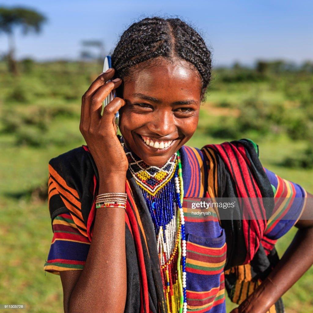 African woman using mobile phone, village near Lalibela, Ethiopia : Stock Photo