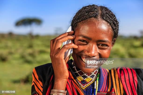 African woman using mobile phone, village near Lalibela, Ethiopia