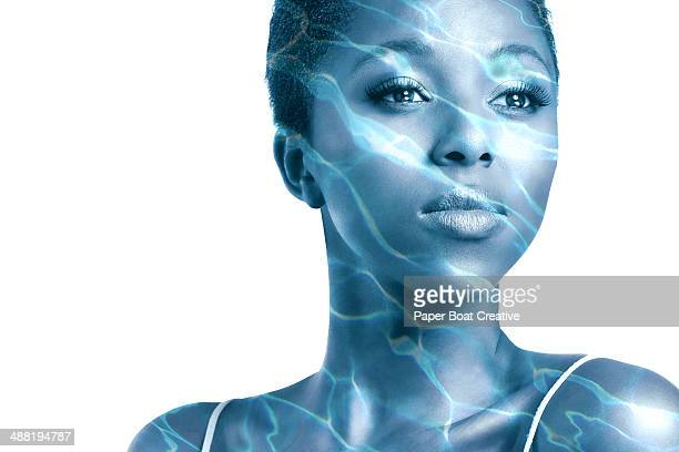 African woman w water ripples over her face