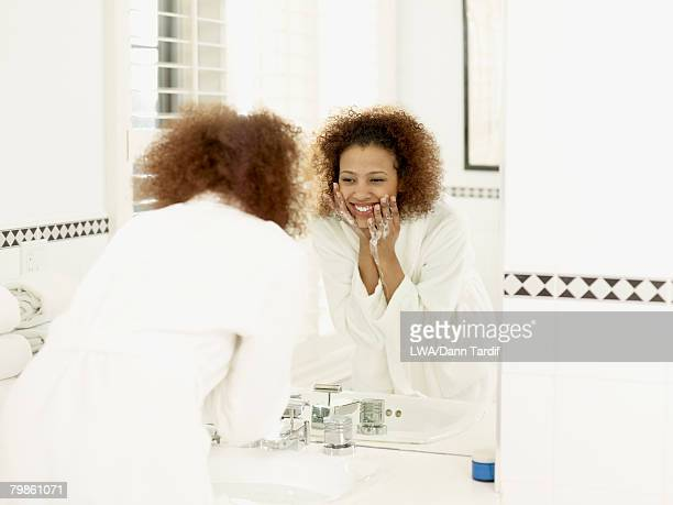 African woman washing face