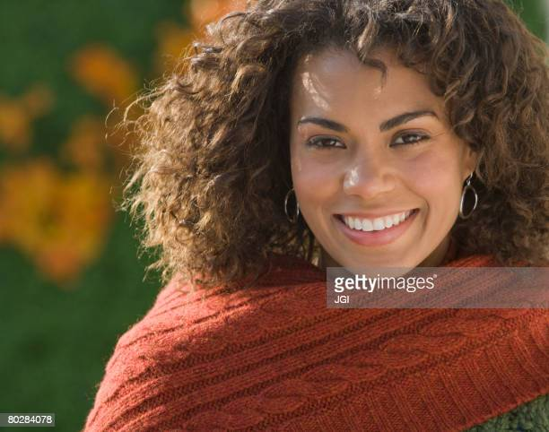 african woman wearing scarf - mid adult woman sweater stock pictures, royalty-free photos & images