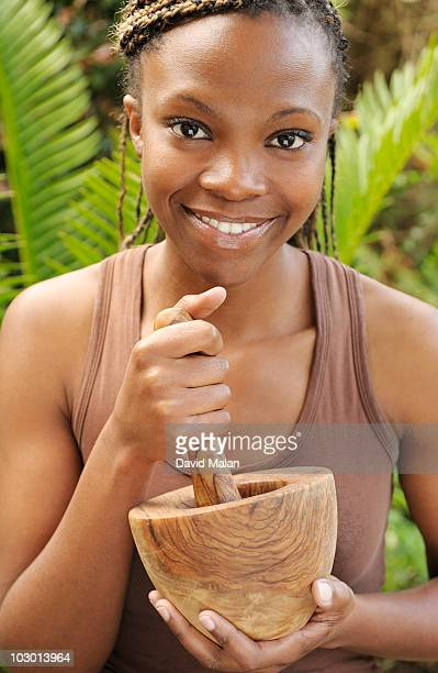 African woman with a mortar and pestle