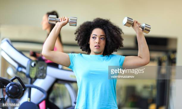 african woman workout with dumbbells in fitness - black female bodybuilder stock photos and pictures
