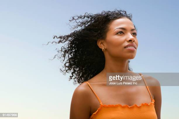 African woman's hair blowing in wind
