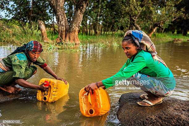 African women are taking water from the river, Ethiopia, Africa
