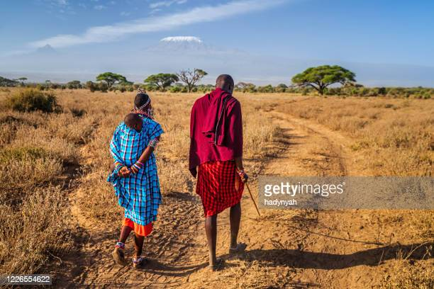 african women carrying her baby, kenya, east africa - east africa stock pictures, royalty-free photos & images