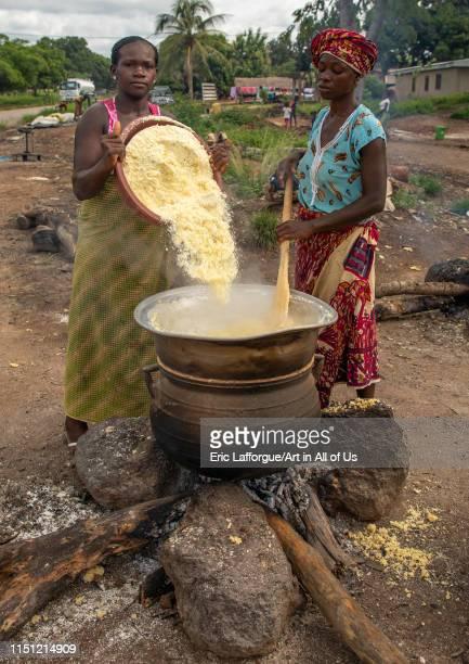 African women cooking attiéké, Région des Lacs, Sakiare, Ivory Coast on May 8, 2019 in Sakiare, Ivory Coast.