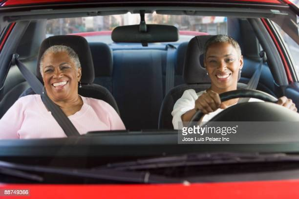 african women driving in car - family inside car stock photos and pictures