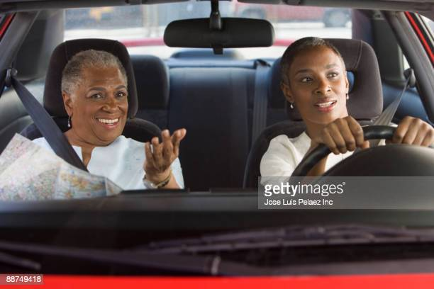 African women driving in car