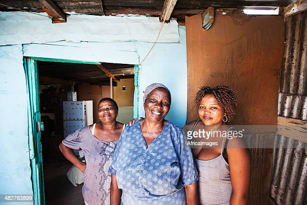 african women outside their home - gugulethu stock pictures, royalty-free photos & images