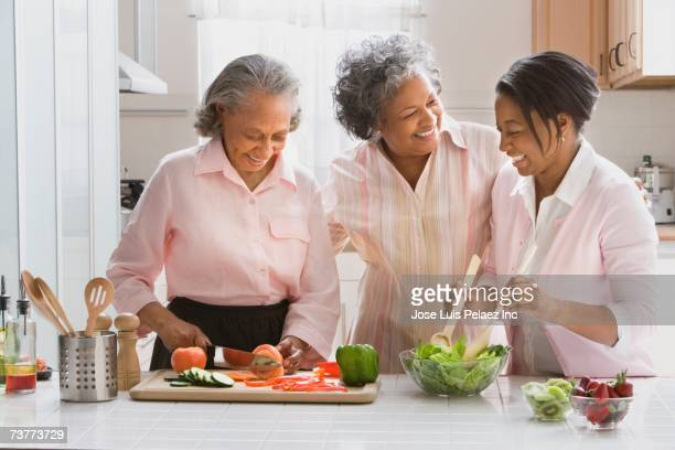 African women preparing food in kitchen