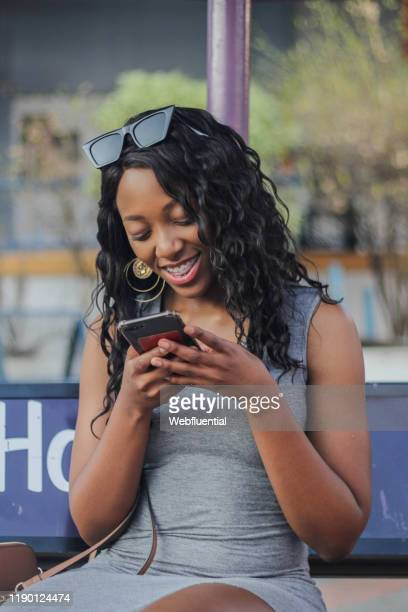 african women texting - webfluential stock pictures, royalty-free photos & images