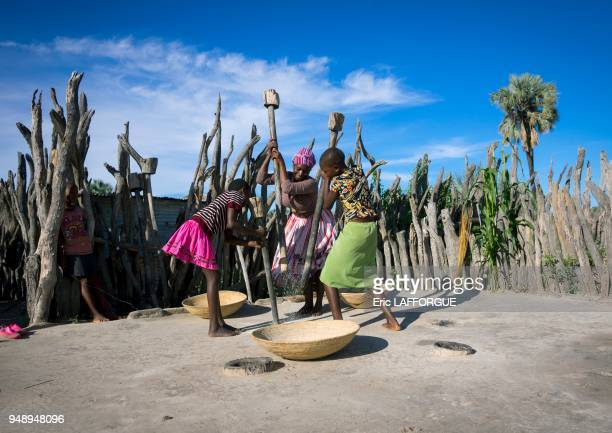 African women with mortars and pestles ondangwa Namibia on March 2 2014 in Ondangwa Namibia