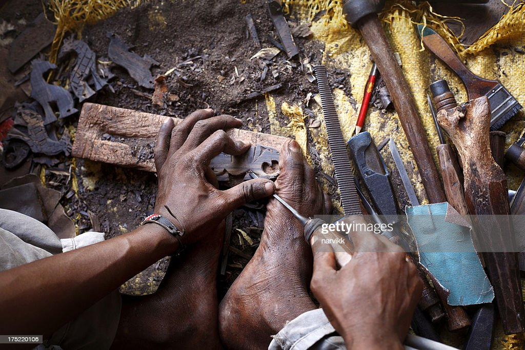 African woodcarver : Stock Photo