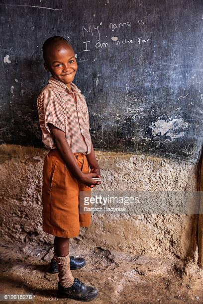African young boy is learning English language, orphanage in Kenya