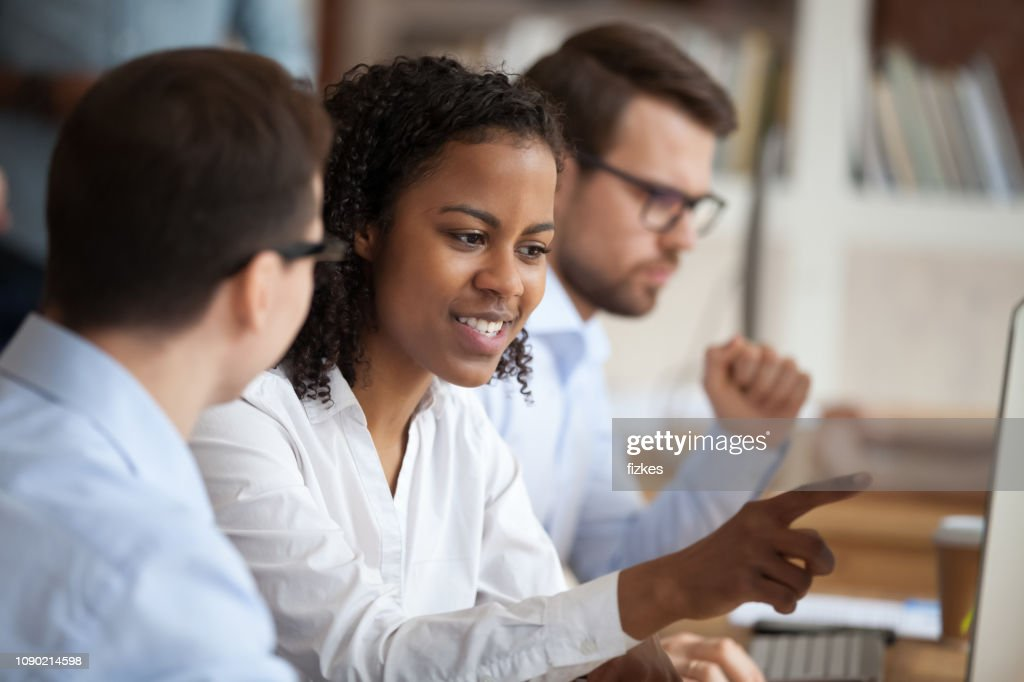 African young intern or mixed-race new employee talking to mentor : Stock Photo