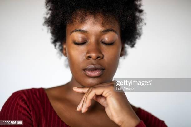 african young woman with eyes closed - met de ogen dicht stockfoto's en -beelden