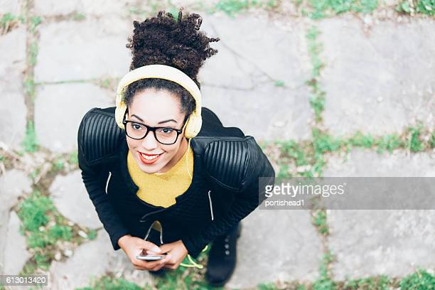 African young woman with yellow headphones