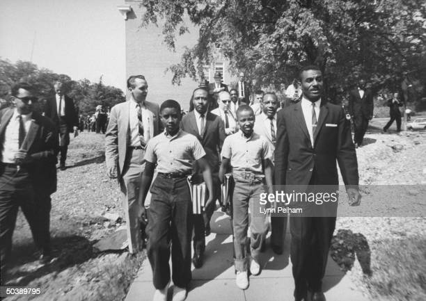 African-Amer. Barber, James Armstrong, escorting sons, Dwight and Floyd, to all-white Graymont school, with the help of Rev. Fred L. Shutllesworth.