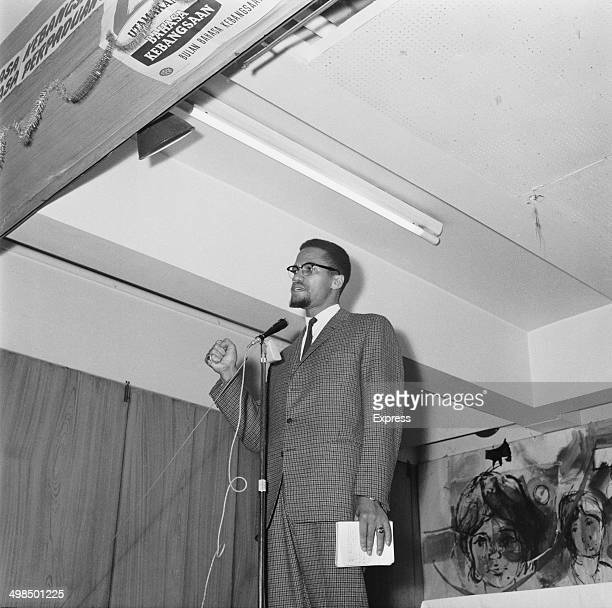 AfricanAmerican activist and Muslim minister Malcolm X makes a speech UK 22nd November 1964 The signs above the stage are in Malay