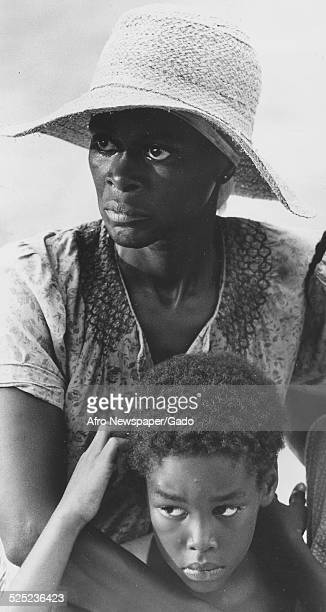 AfricanAmerican actress Cicely Tyson and children acting in the film Sounder about a sharecropper 1975