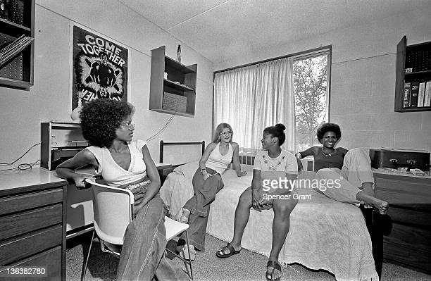 AfricanAmerican and white Jackson girls socialize in their dorm room Medford Massachusetts mid 1970s
