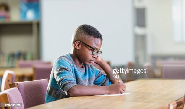 african-american boy in elementary school, writing - school detention stock pictures, royalty-free photos & images