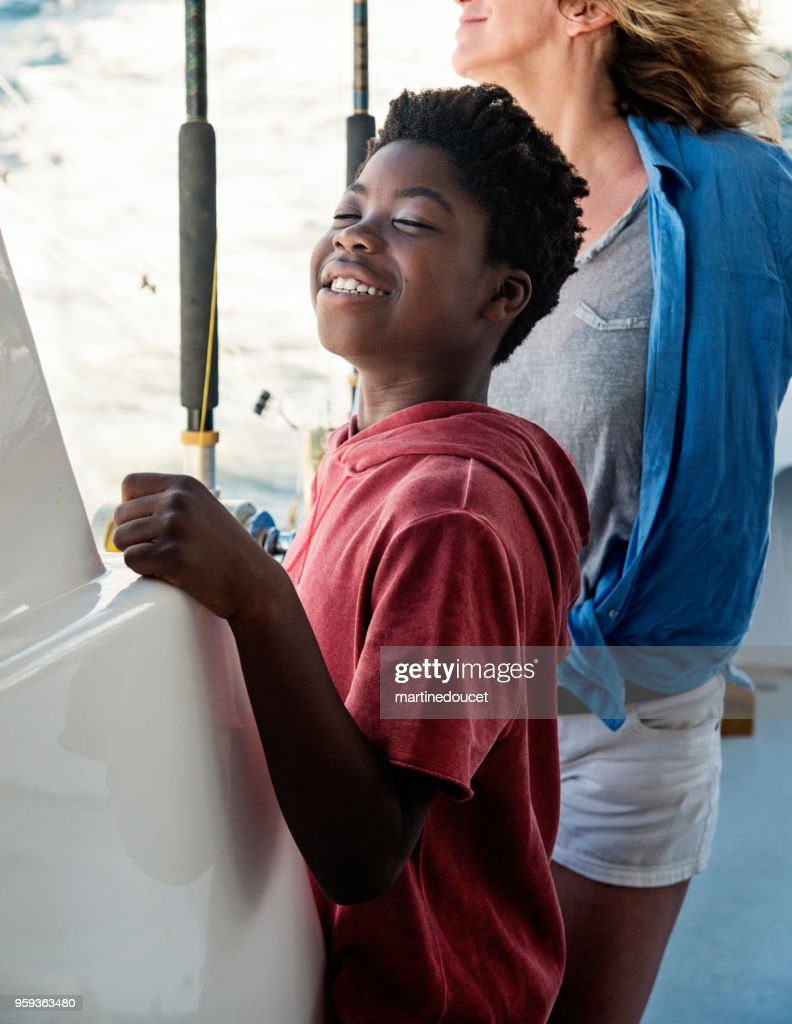 African-american boy on a fishing trip with mother. : Stock Photo