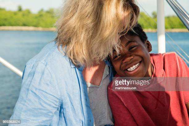 African-american boy on a fishing trip with mother.