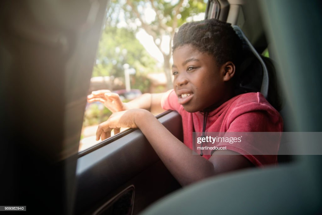 African-american boy on the back seat of a car. : Stock Photo