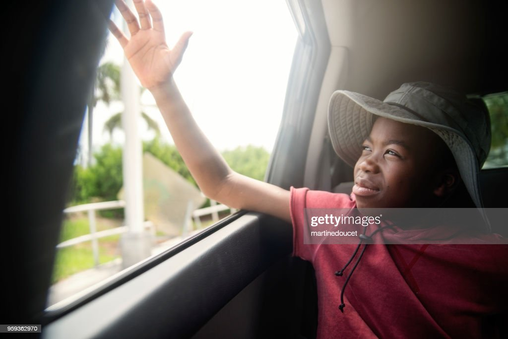 African-american boy on the back seat of a car. : Foto stock