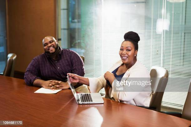african-american business people in meeting - fat woman sitting on man stock pictures, royalty-free photos & images