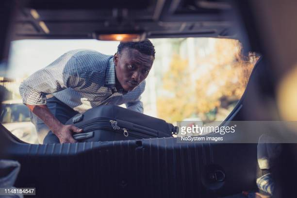african-american businessman on a business trip, travelling by a car - black boot stock pictures, royalty-free photos & images