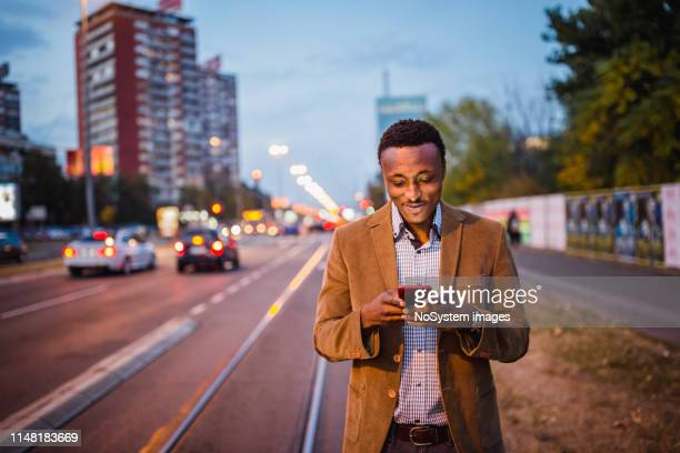 African-American businessman on a business trip using mobile phone