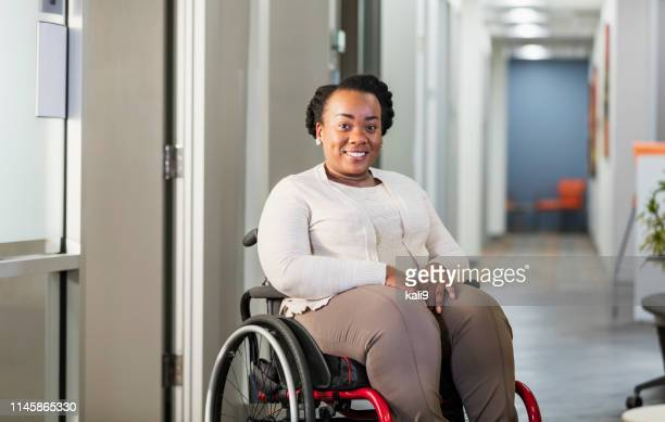 african-american businesswoman in wheelchair - differing abilities female business stock pictures, royalty-free photos & images